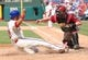 Jul 27, 2014; Philadelphia, PA, USA; Philadelphia Phillies catcher Wil Nieves (21) slides safe into home past the tag attempt of Arizona Diamondbacks catcher Miguel Montero (26) during the seventh inning of a game at Citizens Bank Park. The Phillies won 4-2. Mandatory Credit: Bill Streicher-USA TODAY Sports