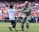 Jul 27, 2014; Philadelphia, PA, USA; United States Servicewomen Yarie Xiomara Valex (R) returns home and surprises her son Jeremy Seth Vralic Valez (L)  on the field during the seventh inning stretch of a game between the Philadelphia Phillies and Arizona Diamondbacks at Citizens Bank Park. The Phillies won 4-2. Mandatory Credit: Bill Streicher-USA TODAY Sports
