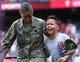 Jul 27, 2014; Philadelphia, PA, USA; Jeremy Seth Vralic Valez (R) sheds tears of joy as his Mom and United States Servicewomen Yarie Xiomara Valex (L) returns home and surprises him on the field during the seventh inning stretch of a game between the Philadelphia Phillies and Arizona Diamondbacks at Citizens Bank Park. The Phillies won 4-2. Mandatory Credit: Bill Streicher-USA TODAY Sports