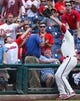 Jul 27, 2014; Philadelphia, PA, USA; Philadelphia Phillies left fielder Darin Ruf (18) reaches into the stands and catches a foul ball for an out to end the fifth inning against the Arizona Diamondbacks at Citizens Bank Park. The Phillies won 4-2. Mandatory Credit: Bill Streicher-USA TODAY Sports