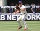 Jul 27, 2014; Philadelphia, PA, USA; Philadelphia Phillies second baseman Chase Utley (26) fields a ball against the Arizona Diamondbacks at Citizens Bank Park. The Phillies won 4-2. Mandatory Credit: Bill Streicher-USA TODAY Sports