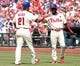 Jul 27, 2014; Philadelphia, PA, USA; Philadelphia Phillies catcher Wil Nieves (21) scores a run and celebrates with shortstop Jimmy Rollins (11) in the seventh inning against the Arizona Diamondbacks at Citizens Bank Park. The Phillies won 4-2. Mandatory Credit: Bill Streicher-USA TODAY Sports