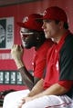 Jul 28, 2014; Cincinnati, OH, USA; Cincinnati Reds second baseman Brandon Phillips (left) sits with first baseman Joey Votto (right) in the dugout during a game with the Arizona Diamondbacks at Great American Ball Park. Mandatory Credit: David Kohl-USA TODAY Sports