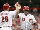 Jul 28, 2014; Cincinnati, OH, USA; Cincinnati Reds catcher Devin Mesoraco (39) is congratulated by left fielder Chris Heisey (28) after Mesoraco hit a solo home run off Arizona Diamondbacks starting pitcher Chase Anderson (not pictured) in the first inning at Great American Ball Park. Mandatory Credit: David Kohl-USA TODAY Sports