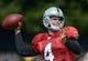 Jul 28, 2014; Napa, CA, USA; Oakland Raiders quarterback Derek Carr (4) throws a pass at training camp at Napa Valley Marriott. Mandatory Credit: Kirby Lee-USA TODAY Sports