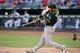 Jul 25, 2014; Arlington, TX, USA; Oakland Athletics right fielder Josh Reddick (16) bats against the Texas Rangers at Globe Life Park in Arlington. The Rangers defeated the Athletics 4-1. Mandatory Credit: Jerome Miron-USA TODAY Sports