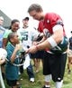 Jul 26, 2014; Philadelphia, PA, USA; Philadelphia Eagles quarterback Nick Foles (9) signs autographs for fans after practice at training camp at the Novacare Complex in Philadelphia PA. Mandatory Credit: Bill Streicher-USA TODAY Sports