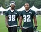 Jul 26, 2014; Philadelphia, PA, USA; Philadelphia Eagles running back Matthew Tucker (39) and running back Chris Polk (32) walk off the field after practice at training camp at the Novacare Complex in Philadelphia PA. Mandatory Credit: Bill Streicher-USA TODAY Sports