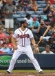 Jul 24, 2014; Atlanta, GA, USA; Atlanta Braves catcher Evan Gattis (24) prepares to bat against Miami Marlins starting pitcher Henderson Alvarez (not pictured) in the first inning of their game at Turner Field. Marlins won 3-2. Mandatory Credit: Jason Getz-USA TODAY Sports