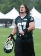 Jul 26, 2014; Philadelphia, PA, USA; Philadelphia Eagles tackle Dennis Kelly (67) walks off the field after practice at training camp at the Novacare Complex in Philadelphia PA. Mandatory Credit: Bill Streicher-USA TODAY Sports