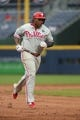 Jul 20, 2014; Atlanta, GA, USA; Philadelphia Phillies right fielder Marlon Byrd (3) rounds the bases after he hit a solo home run in the ninth inning of their game against the Atlanta Braves at Turner Field. The Braves won 8-2. Mandatory Credit: Jason Getz-USA TODAY Sports