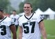 Jul 26, 2014; Philadelphia, PA, USA; Philadelphia Eagles outside linebacker Travis Long (57) after practice at training camp at the Novacare Complex in Philadelphia PA. Mandatory Credit: Bill Streicher-USA TODAY Sports