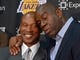 Jul 29, 2014; El Segundo, CA, USA; Byron Scott (left) is embraced by Magic Johnson at a press conference to introduce Scott as Los Angeles Lakers coach at Toyota Sports Center. Mandatory Credit: Kirby Lee-USA TODAY Sports