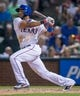 Jul 25, 2014; Arlington, TX, USA; Texas Rangers shortstop Elvis Andrus (1) bats during the game against the Oakland Athletics at Globe Life Park in Arlington. The Rangers defeated the Athletics 4-1. Mandatory Credit: Jerome Miron-USA TODAY Sports