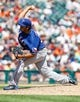 July 14, 2013; Detroit, MI, USA; Texas Rangers relief pitcher Wilmer Font (53) pitches in the eighth inning against the Detroit Tigers at Comerica Park. Mandatory Credit: Rick Osentoski-USA TODAY Sports