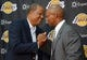 Jul 29, 2014; El Segundo, CA, USA; New head coach Byron Scott (right) shakes hands with former Lakers player Jamaal Wilkes at a press conference to announce Scott as Los Angeles Lakers coach at Toyota Sports Center. Mandatory Credit: Kirby Lee-USA TODAY Sports