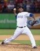 Jul 25, 2014; Arlington, TX, USA; Texas Rangers relief pitcher Neftali Feliz (30) pitches against the Oakland Athletics during the game at Globe Life Park in Arlington. The Rangers defeated the Athletics 4-1. Mandatory Credit: Jerome Miron-USA TODAY Sports