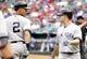 Jul 29, 2014; Arlington, TX, USA;  New York Yankees left fielder Brett Gardner (11) is congratulated by shortstop Derek Jeter (2) after his home run in the first inning against the Texas Rangers at Globe Life Park in Arlington. Mandatory Credit: Tim Heitman-USA TODAY Sports