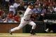 Jul 29, 2014; Arlington, TX, USA; New York Yankees shortstop Derek Jeter (2) hits an infield single in the sixth inning against the Texas Rangers at Globe Life Park in Arlington. Mandatory Credit: Tim Heitman-USA TODAY Sports