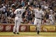 Jul 29, 2014; Arlington, TX, USA; New York Yankees first baseman Mark Teixeira (25) is congratulated by third base coach Rob Thomson (59) after hitting a home run in the eighth inning against the Texas Rangers at Globe Life Park in Arlington.  New York beat Texas 12-11. Mandatory Credit: Tim Heitman-USA TODAY Sports