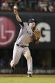 Jul 29, 2014; Arlington, TX, USA; New York Yankees third baseman Chase Headley (12) throws to first base in the game against the Texas Rangers at Globe Life Park in Arlington.  New York beat Texas 12-11. Mandatory Credit: Tim Heitman-USA TODAY Sports