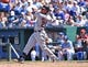 Jul 27, 2014; Kansas City, MO, USA; Cleveland Indians center fielder Michael Brantley (23) singles against the Kansas City Royals during the seventh inning at Kauffman Stadium. Mandatory Credit: Peter G. Aiken-USA TODAY Sports