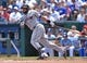 Jul 27, 2014; Kansas City, MO, USA; Cleveland Indians first basemen Carlos Santana (41) at bat against the Kansas City Royals during the second inning at Kauffman Stadium. Mandatory Credit: Peter G. Aiken-USA TODAY Sports