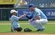 Jul 27, 2014; Kansas City, MO, USA; Kansas City Royals third basemen Mike Moustakas (8) gives a fist pump to a young fan prior to the game against the Cleveland Indians at Kauffman Stadium. Mandatory Credit: Peter G. Aiken-USA TODAY Sports