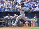 Jul 27, 2014; Kansas City, MO, USA; Cleveland Indians base runner Jose Ramirez (11) scores against the Kansas City Royals during the fifth inning at Kauffman Stadium. Mandatory Credit: Peter G. Aiken-USA TODAY Sports
