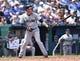 Jul 27, 2014; Kansas City, MO, USA; Cleveland Indians shortstop Asdrubal Cabrera (13) at bat against the Kansas City Royals during the fifth inning at Kauffman Stadium. Mandatory Credit: Peter G. Aiken-USA TODAY Sports