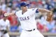 Jul 30, 2014; Arlington, TX, USA; Texas Rangers starting pitcher Colby Lewis (48) throws a pitch in the first inning against the New York Yankees at Globe Life Park in Arlington. Mandatory Credit: Tim Heitman-USA TODAY Sports