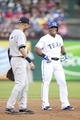 Jul 30, 2014; Arlington, TX, USA; Texas Rangers third baseman Adrian Beltre (29) laughs with New York Yankees shortstop Derek Jeter (2) during the first inning at Globe Life Park in Arlington. Mandatory Credit: Tim Heitman-USA TODAY Sports