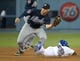Jul 30, 2014; Los Angeles, CA, USA; Atlanta Braves second baseman Tommy La Stella (7) tags out Los Angeles Dodgers second baseman Dee Gordon (9) on a stolen base attempt in the third inning at Dodger Stadium. Mandatory Credit: Kirby Lee-USA TODAY Sports