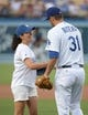 Jul 30, 2014; Los Angeles, CA, USA; British Open womens winner Mo Martin (left) shakes hands with Los Angeles Dodgers catcher Drew Butera (31) before the game against the Atlanta Braves at Dodger Stadium. Mandatory Credit: Kirby Lee-USA TODAY Sports