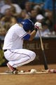 Jul 30, 2014; Arlington, TX, USA; Texas Rangers designated hitter Shin-Soo Choo (17) waits in the on deck circle during the game against the New York Yankees at Globe Life Park in Arlington.  Texas beat New York 3-2. Mandatory Credit: Tim Heitman-USA TODAY Sports