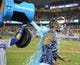 Jul 30, 2014; Los Angeles, CA, USA; Los Angeles Dodgers right fielder Matt Kemp is doused by a cooler of Powerade after hitting a walk-off single in the 10th inning against the Atlanta Braves at Dodger Stadium. The Dodgers defeated the Braves 2-1 in 10 innings. Mandatory Credit: Kirby Lee-USA TODAY Sports