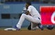 Jul 31, 2014; Los Angeles, CA, USA; Los Angeles Dodgers second baseman Dee Gordon (9) reacts to getting thrown out attempting to steal 2nd base against the Atlanta Braves in the 1st inning at Dodger Stadium. Mandatory Credit: Robert Hanashiro-USA TODAY Sports