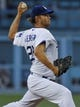 Jul 31, 2014; Los Angeles, CA, USA; Los Angeles Dodgers starting pitcher Clayton Kershaw (22) throws in the 2nd inning against the Atlanta Braves at Dodger Stadium. Mandatory Credit: Robert Hanashiro-USA TODAY Sports