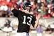 Aug 1, 2014; Lawrenceville, GA, USA; Atlanta Falcons quarterback T.J. Yates (13) passes during practice during Falcons Friday Night Lights at Archer High School. Mandatory Credit: Dale Zanine-USA TODAY Sports