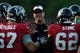 Aug 1, 2014; Lawrenceville, GA, USA; Atlanta Falcons offensive line coach Mike Tice (hat) talks to the players during practice during Falcons Friday Night Lights at Archer High School. Mandatory Credit: Dale Zanine-USA TODAY Sports