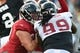 Aug 1, 2014; Lawrenceville, GA, USA; Atlanta Falcons offensive tackle Jake Matthews (70) blocks defensive end Tyson Jackson (99) during practice during Falcons Friday Night Lights at Archer High School. Mandatory Credit: Dale Zanine-USA TODAY Sports