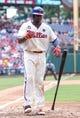 Jul 27, 2014; Philadelphia, PA, USA; Philadelphia Phillies first baseman Ryan Howard (6) flips his bat after drawing a walk in a game against the Arizona Diamondbacks at Citizens Bank Park. The Phillies won 4-2. Mandatory Credit: Bill Streicher-USA TODAY Sports