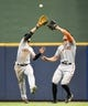 Aug 5, 2014; Milwaukee, WI, USA;  San Francisco Giants center fielder Gregor Blanco (L) avoids a collision with right fielder Hunter Pence (R) while catching a flyball hit by Milwaukee Brewers right fielder Ryan Braun (not pictured) at Miller Park in the fourth inning. Mandatory Credit: Benny Sieu-USA TODAY Sports