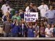 Aug 5, 2014; Denver, CO, USA; Chicago Cubs fans hold up a sign for second baseman Javier Baez (not pictured) after the game against the Colorado Rockies at Coors Field. The Cubs won 6-5 in twelve innings.  Mandatory Credit: Chris Humphreys-USA TODAY Sports