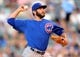 Aug 6, 2014; Denver, CO, USA; Chicago Cubs starting pitcher Jake Arrieta (49) delivers a pitch in the second inning against the Colorado Rockies at Coors Field. Mandatory Credit: Ron Chenoy-USA TODAY Sports