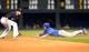 Aug 6, 2014; Denver, CO, USA; Chicago Cubs catcher Welington Castillo (5) slides to steal second base against Colorado Rockies shortstop Josh Rutledge (14) in the sixth inning at Coors Field. Mandatory Credit: Ron Chenoy-USA TODAY Sports