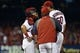 Aug 7, 2014; St. Louis, MO, USA;  St. Louis Cardinals catcher Tony Cruz (48) talks with Adam Wainwright (50) and  pitching coach Derek Lilliquist (34) at Busch Stadium. Mandatory Credit: Jasen Vinlove-USA TODAY Sports