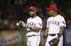Jul 28, 2014; Arlington, TX, USA; Texas Rangers shortstop Elvis Andrus (left) and third baseman Adrian Beltre (29) speak during the game against the New York Yankees at Globe Life Park in Arlington. Mandatory Credit: Kevin Jairaj-USA TODAY Sports