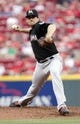 Aug 8, 2014; Cincinnati, OH, USA; Miami Marlins starting pitcher Nathan Eovaldi (24) pitches during the first inning against the Cincinnati Reds at Great American Ball Park. Mandatory Credit: Frank Victores-USA TODAY Sports