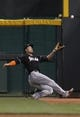 Aug 8, 2014; Cincinnati, OH, USA; Miami Marlins right fielder Giancarlo Stanton (27) makes a catch during the sixth inning against the Cincinnati Reds at Great American Ball Park. The Marlins won 2-1. Mandatory Credit: Frank Victores-USA TODAY Sports